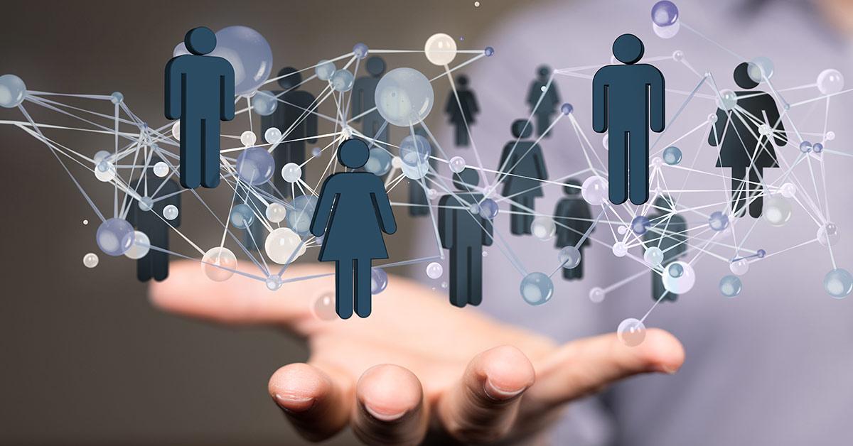Auf dem Bild sieht man eine Hand, über der ein Netzwerk von Menschen grafisch dargestellt wurde.